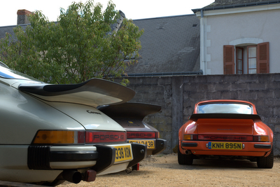 Andy's 911 carrera 3.2 and a pair of Carrera 3.0s line up outside the gite