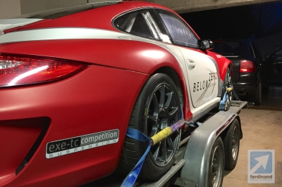 Cayenne towing Porsche 997 rally car